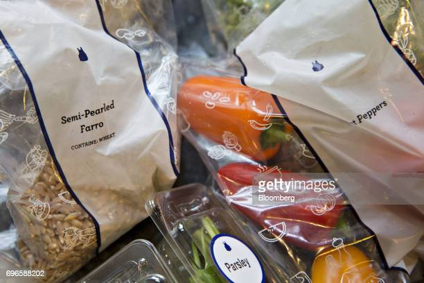 Vegetables and grains from a Blue Apron Holdings Inc mealkit delivery are arranged for a photograph in Tiskilwa Illinois US on Wednesday June 14 2017...