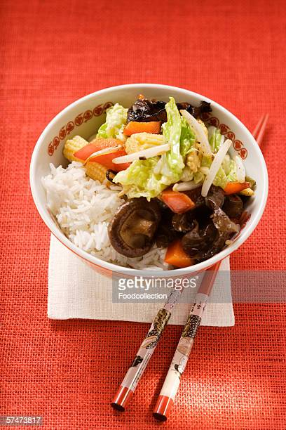 Vegetables and mushrooms cooked in wok on rice (Asia)