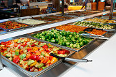 Vegetables and other foods in free-flo restaurant