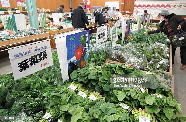 Vegetables are displayed at a farmers market on March 20 2011 in Fukushima Japan The spinach and milk with radioactive iodine exceeding the...