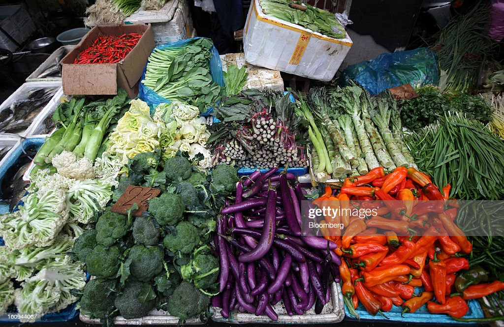 Vegetables are displayed for sale at a market stall in Shanghai, China, on Thursday, Feb. 7, 2013. China's consumer prices rose 2 percent in January from a year earlier while the producer-price index dropped 1.6 percent, the National Bureau of Statistics said today in Beijing. Photographer: Tomohiro Ohsumi/Bloomberg via Getty Images