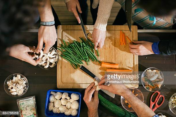 Vegetables being cut in cooking class