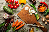 Slicing fresh vegetables for cooking. Healthy eating concept