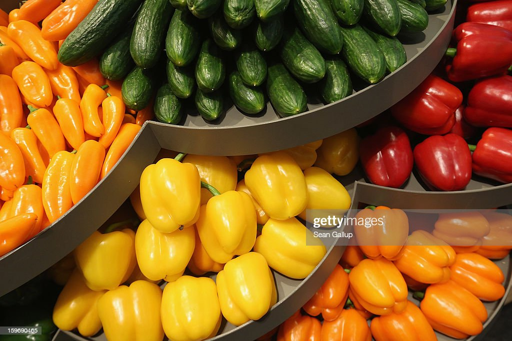 Vegetables from Holland, including cucumbers, yellow, green, red and orange peppers lie on display at a Dutch stand at the 2013 Gruene Woche agricultural trade fair on January 18, 2013 in Berlin, Germany. The Gruene Woche, which is the world's largest agricultural trade fair, runs from January 18-27, and this year's partner country is Holland.
