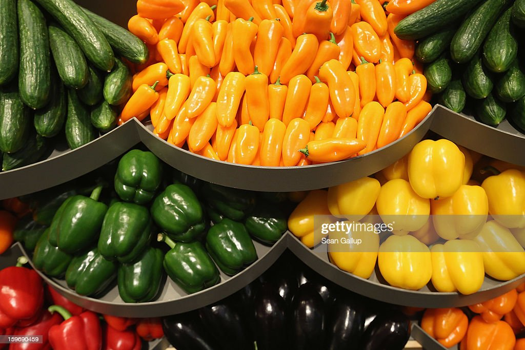 Vegetables from Holland, including yellow, green, red and orange peppers, cucumbers and aubergine lie on display at a Dutch stand at the 2013 Gruene Woche agricultural trade fair on January 18, 2013 in Berlin, Germany. The Gruene Woche, which is the world's largest agricultural trade fair, runs from January 18-27, and this year's partner country is Holland.