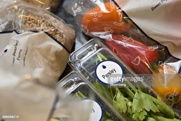 Vegetables herbs and grains from a Blue Apron Holdings Inc mealkit delivery are arranged for a photograph in Tiskilwa Illinois US on Wednesday June...
