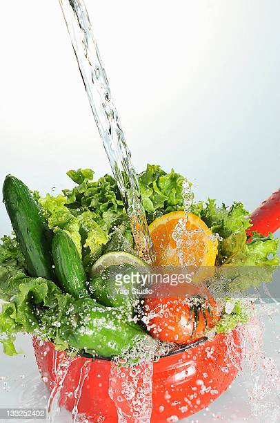 Vegetables in a red pot,and water