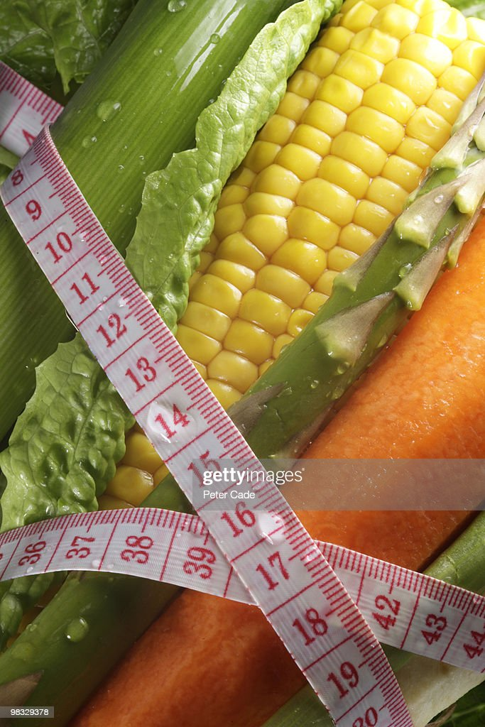 Vegetables in a tape measure : Stock Photo