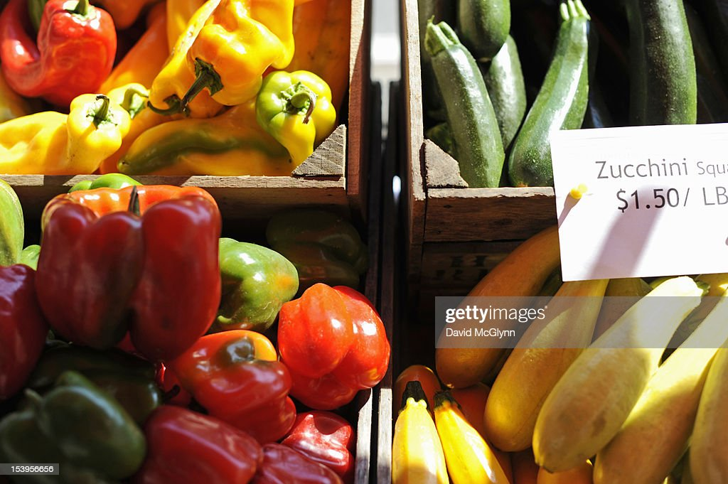 Vegetables in boxes at a farmer's market : Stock Photo