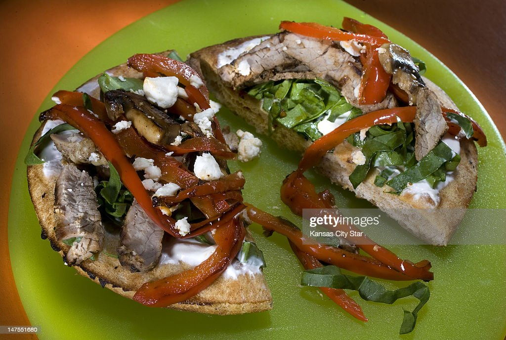 Vegetables, lean beef and whole-wheat pita bread make a quick and healthier pizza.