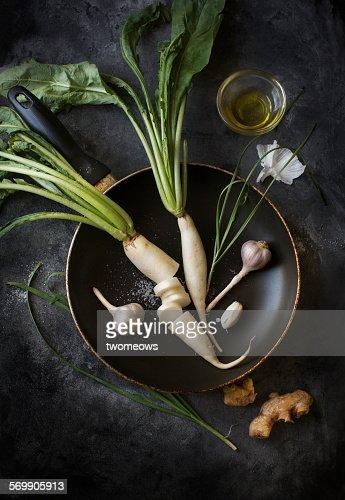 Vegetables on black rustic table top.