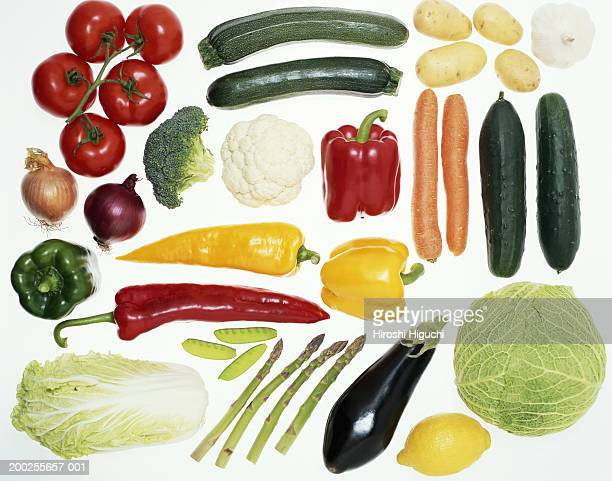 Vegetables on illuminated white surface, overhead view