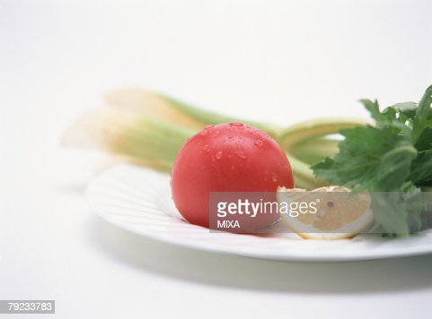 Vegetables on plate, close-up : Stock Photo