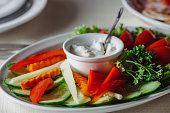 Platter of assorted fresh vegetables with sauce