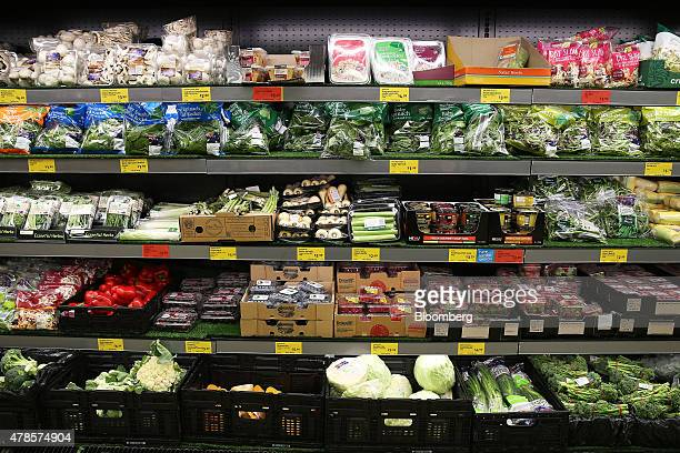 Vegetables sit on display for sale at an Aldi Stores Ltd food store in Sydney Australia on Thursday June 25 2015 Australia's biggest supermarkets are...