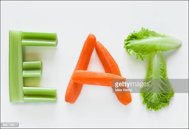 Vegetables spelling the word eat
