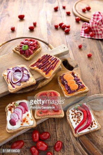 Vegetarian appetizers and bruschetta on wooden cho