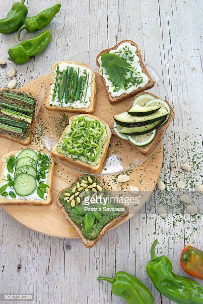 vegetarian appetizers and bruschetta on wooden pla