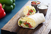 Vegetarian breakfast burrito with eggs and bell pepper