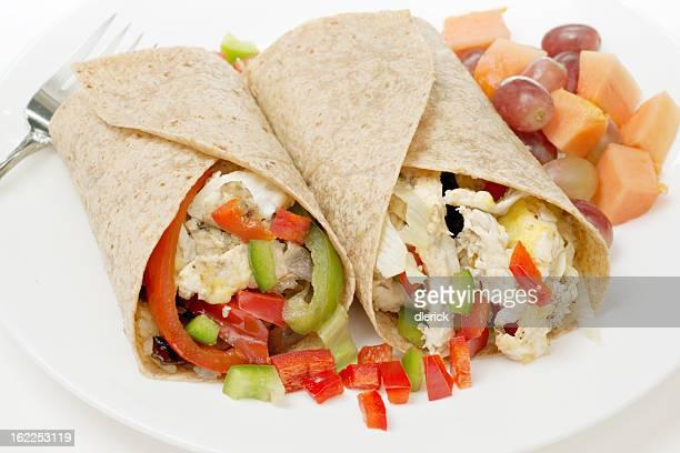 Vegetarian breakfast burrito with eggs, potatoes, cheese
