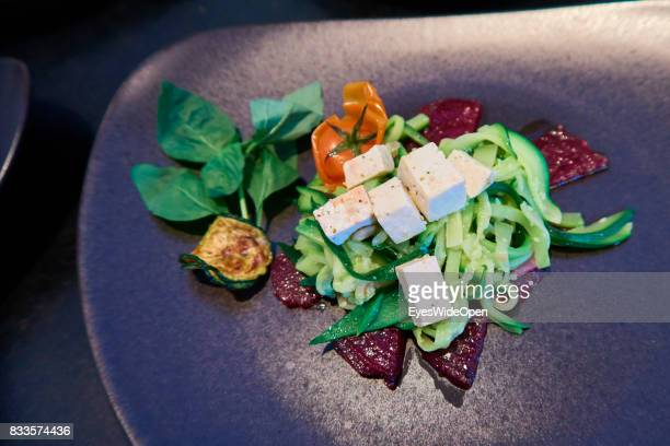 Vegetarian dish with beet roots and zucchini pasta and vegetables d on April 21 2015 in Lana Italy