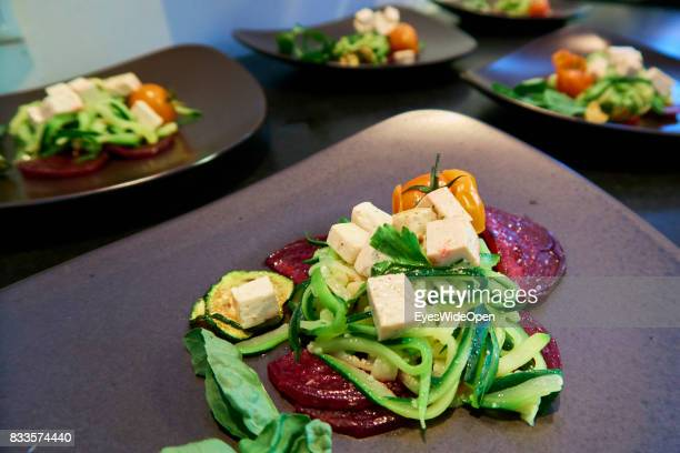Vegetarian dishes with beet roots and zucchini pasta and vegetables d on April 21 2015 in Lana Italy