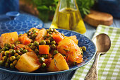 Vegetarian food - potatoes with pea and tomatoes, greek style cuisine.