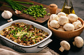 Vegetarian rice casserole with mushrooms, leek and garlic.