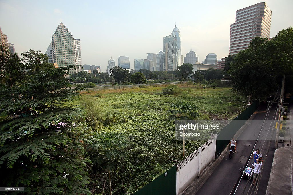 Vegetation grows on a plot of land along Langsuan road in Bangkok, Thailand, on Tuesday, Dec. 11, 2012. The Crown Property Bureau owns about 41,300 rai (66 square kilometers) of land across the country, about a fifth of which is in Bangkok, according to Aviruth Wongbuddhapitak, an adviser to the CPB who sits on the board of two of its subsidiaries. Photographer: Dario Pignatelli/Bloomberg via Getty Images