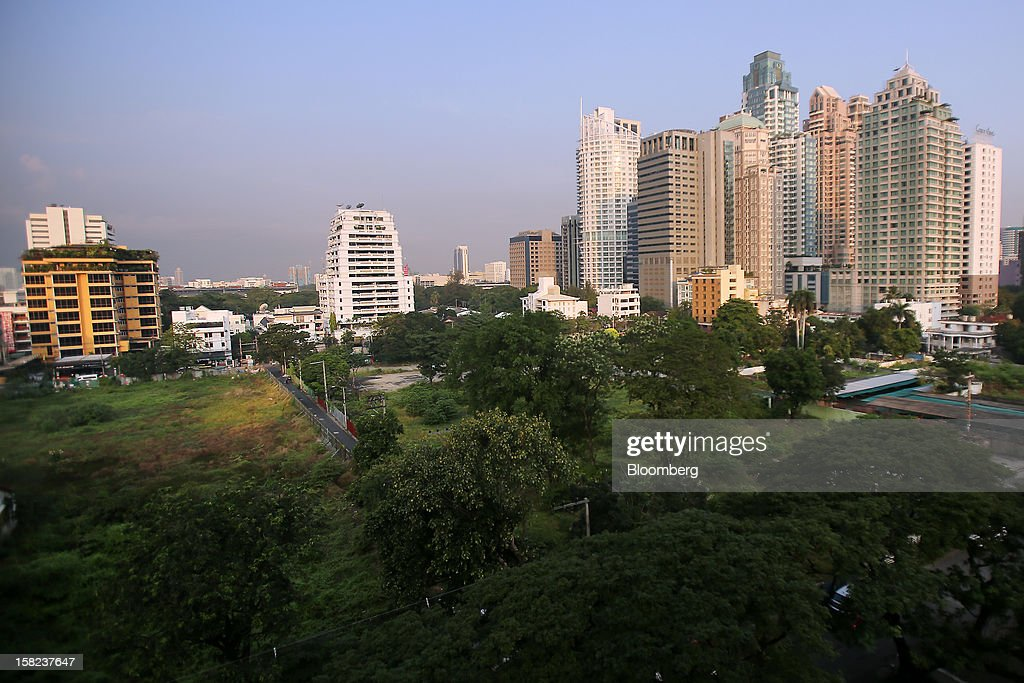 Vegetation grows on plots of land along Langsuan road as high rise buildings stand in the background in Bangkok, Thailand, on Tuesday, Dec. 11, 2012. The Crown Property Bureau owns about 41,300 rai (66 square kilometers) of land across the country, about a fifth of which is in Bangkok, according to Aviruth Wongbuddhapitak, an adviser to the CPB who sits on the board of two of its subsidiaries. Photographer: Dario Pignatelli/Bloomberg via Getty Images