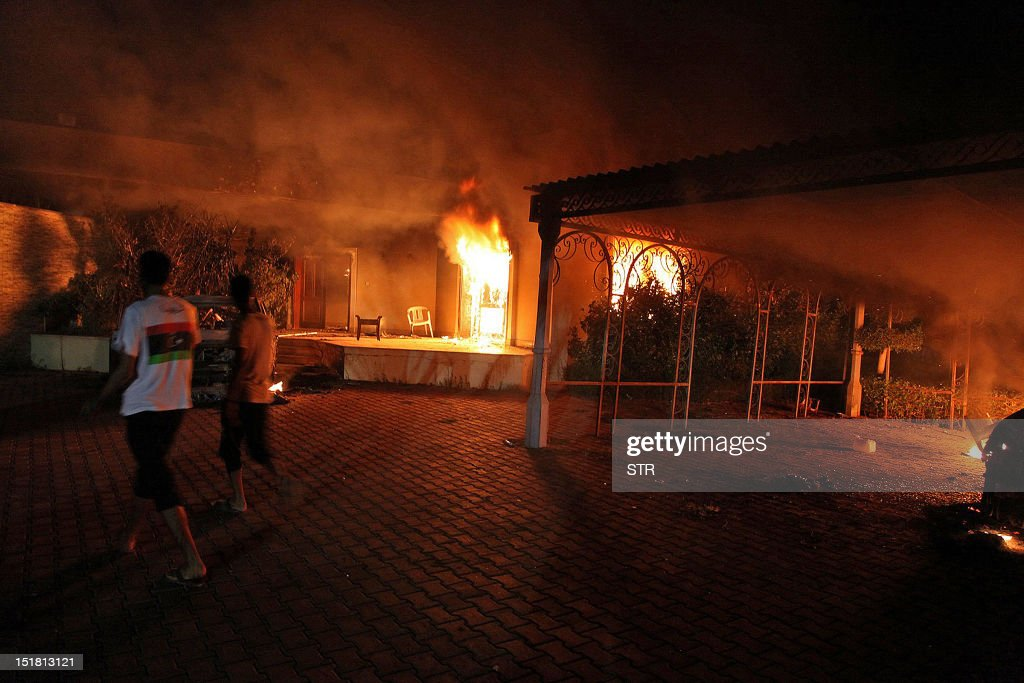 A vehicle and the surround buildings burn after they were set on fire inside the US consulate compound in Benghazi late on September 11 2012 An armed...