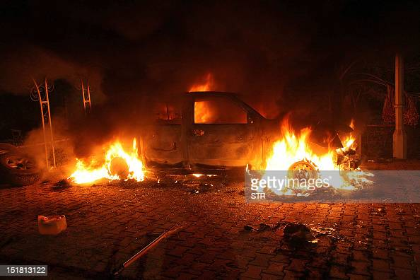 A vehicle and the surrounding area are engulfed in flames after it was set on fire inside the US consulate compound in Benghazi late on September 11...