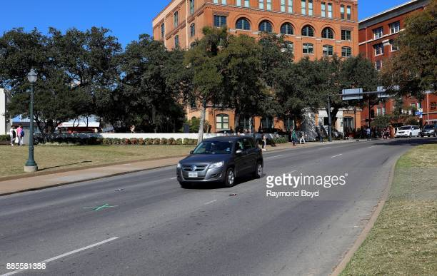 A vehicle approaches the 'X' along Elm Street which is the site where President John F Kennedy was assassinated on November 22 1963 in Dallas Texas...