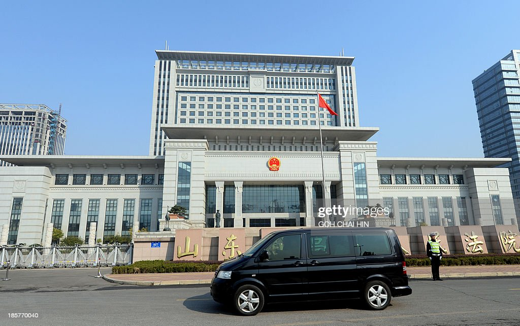A vehicle believed to be ferrying once-powerful politician Bo Xilai, arrives at the Shandong high court building in Jinan, east China Shandong province on October 25, 2013. The court will deliver the ruling on the appeal of Bo -- formerly one of the country's top 25 leaders, who ran the southwestern megacity of Chongqing -- was sentenced to life in prison in September by the Intermediate People's Court in Jinan.