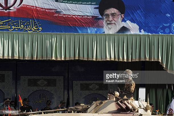 A vehicle carries a tank and its commander during a military parade commemorating the 31st anniversary of IranIraq war on September 22 2011 in Tehran...