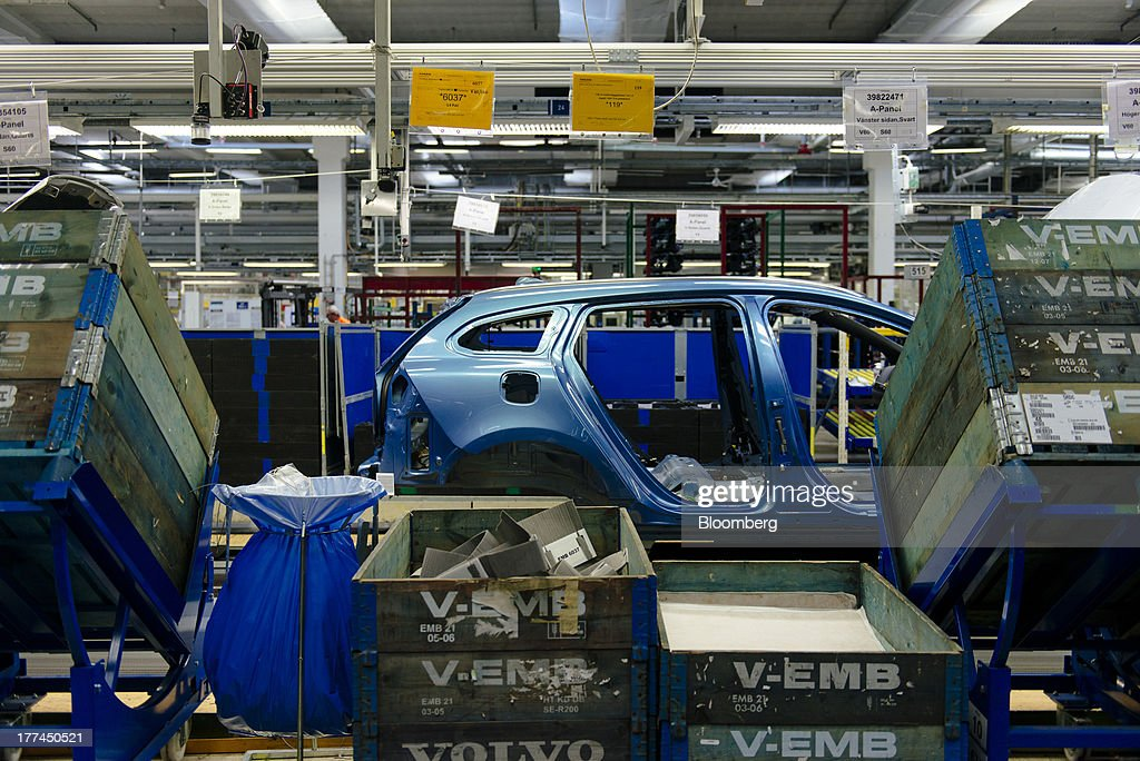 A vehicle chassis moves along the production line past parts boxes at the Volvo Cars plant in Torslanda, Sweden, on Thursday, Aug. 22, 2013. Volvo Cars Chief Executive Officer Hakan Samuelsson will settle a German investigation into corruption allegations linked to his tenure as MAN SE's CEO by paying 500,000 euros ($668,000) to charity. Photographer: Kristian Helgesen/Bloomberg via Getty Images
