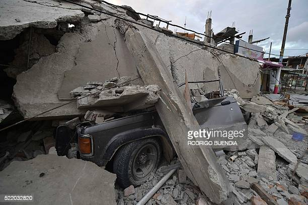 A vehicle crashed under the rubble is seen in one of Ecuador's worsthit towns Pedernales a day after a 78magnitude quake hit the country on April 17...