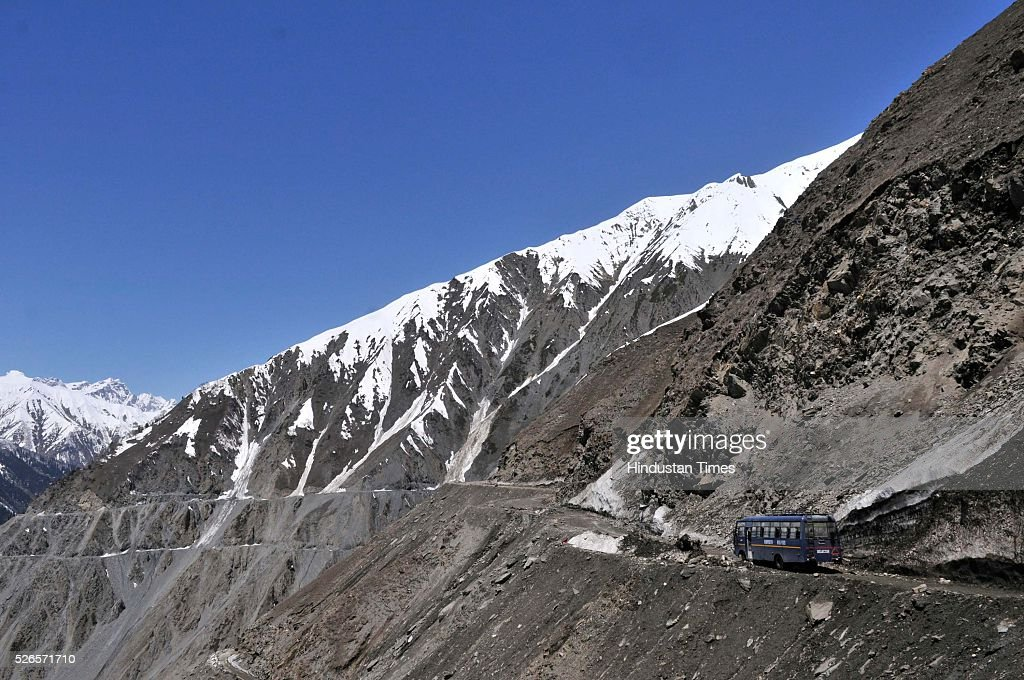 A vehicle cross through a snow bound Zojila pass, 108 kilometers (67 miles) east of Srinagar, on April 30, 2016 in Srinagar, India. The Srinagar-Leh road link was thrown open for vehicular traffic after around five months. India's Border Roads Organisation (BRO) which maintains the road opened it after clearing the snow from Zojila Pass, 3630 meters above sea level. The 434-km Srinagar-Leh National Highway, the only road linking Kashmir with frontier region of Ladakh, has been partially thrown open to vehicular traffic after remaining closed for over six months owing to heavy snowfall during winter. The Pass attracts the heaviest snowfall during the winter and as such it remains closed to traffic for five to six months in a year.
