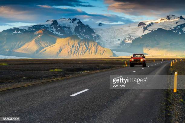 4WD vehicle crossing a mountain landscape in south Iceland