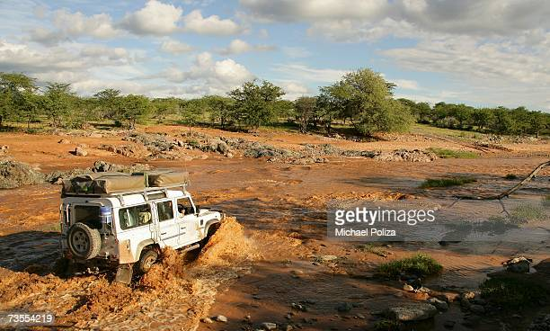 4X4 Vehicle Crossing a Muddy River in Flood