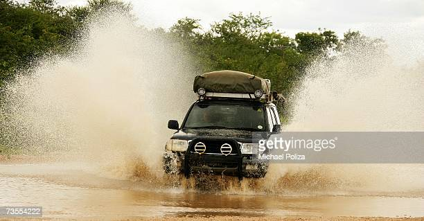 4X4 Vehicle Crossing a Muddy River