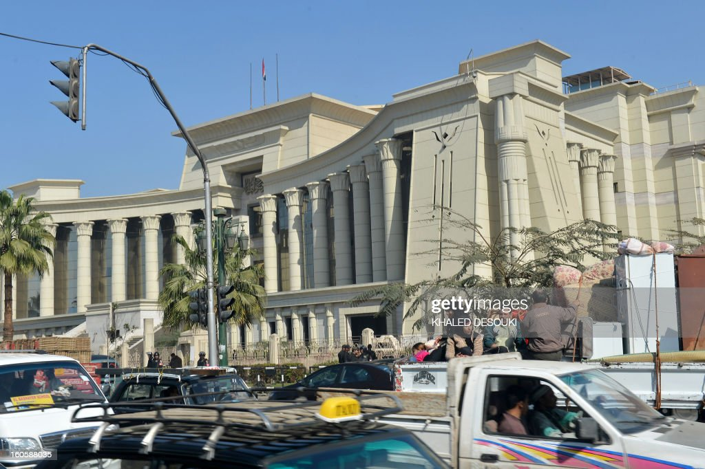 Vehicle drive past the Supreme Constitutional Court in Cairo, on February 3, 2013 as Egypt's top court postponed until March 3, a ruling on the legality of the Islamist-dominated commission that drafted a contested new constitution, state media reported.