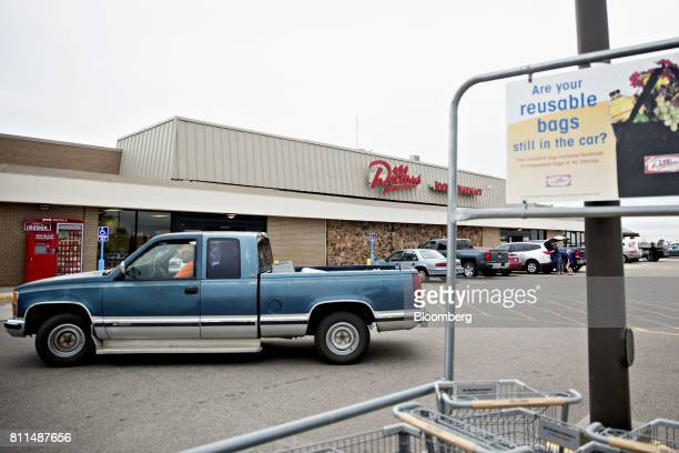 A vehicle drives past a Dillons Food Stores supermarket owned by Kroger Co in Hays Kansas US on Thursday June 29 2017 Kroger remains committed to its...