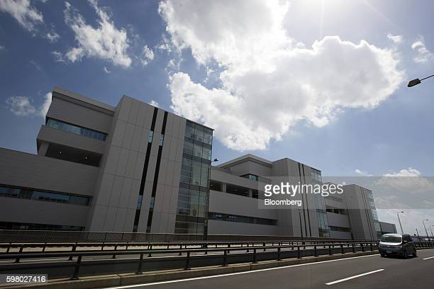 A vehicle drives past the under construction Toyosu Market in Tokyo Japan on Wednesday Aug 31 2016 Yuriko Koike governor of Tokyo announced Wednesday...