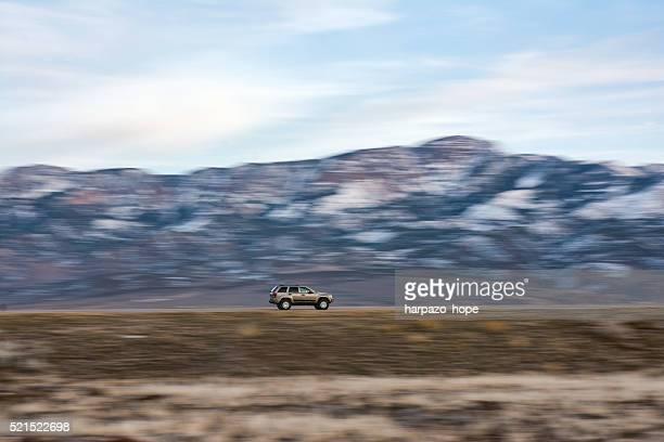 Vehicle driving through rural Utah.