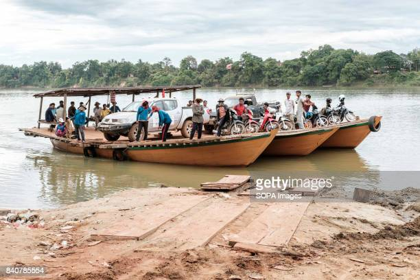 A vehicle ferry is seen at a popular crossing on the Sesan river The boat is loaded with motorcycle and an SUV belonging to an international NGO...