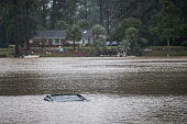 A vehicle floats in a small lake in the Forest Acres neighborhood October 5 2015 in Columbia South Carolina The state of South Carolina experienced...