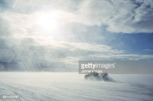 Vehicle in snowy landscape