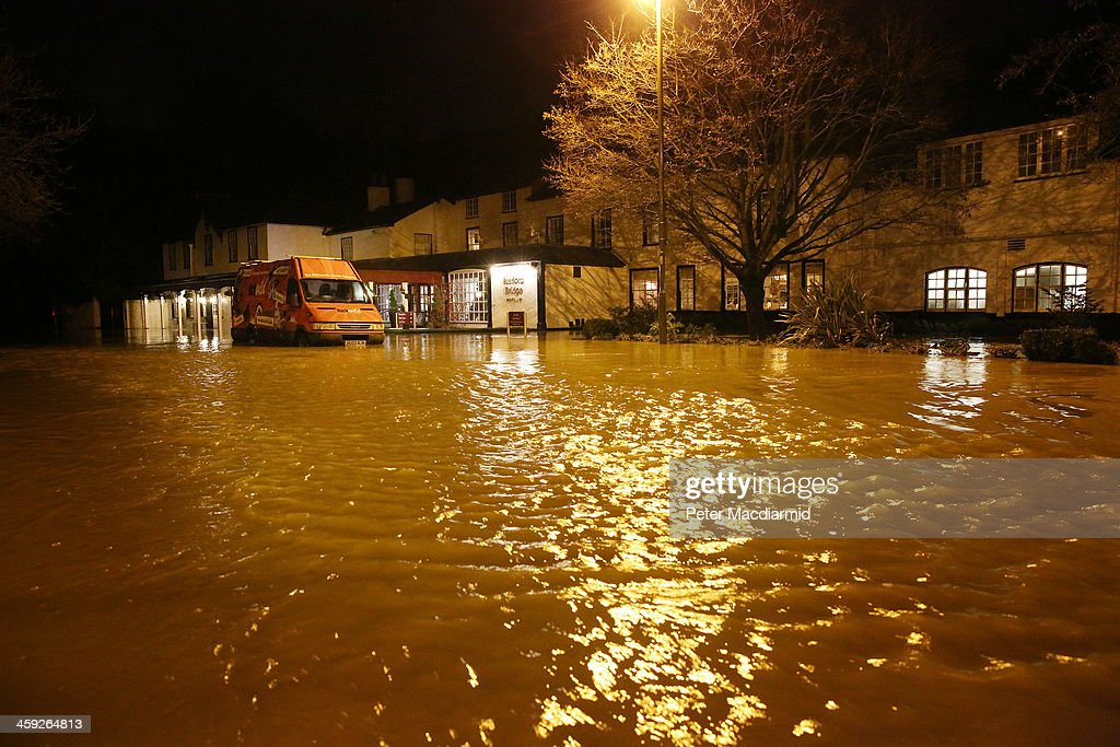 A vehicle is abandoned in rising floodwater from the River Mole at the Burford Bridge Hotel on December 24, 2013 near Dorking, England. Christmas plans have been badly affected for thousands of people after storms across the UK have resulted in flooding, power cuts and significant problems with transport infrastructure.