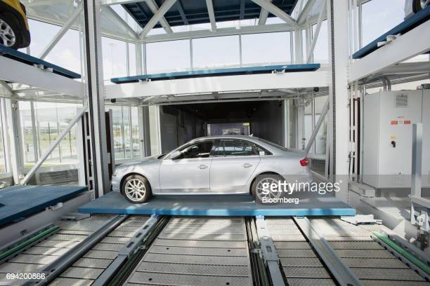 A vehicle is moved onto the retrieval platform at the Carvana Co car vending machine in Frisco Texas US on Thursday June 8 2017 The US automotive...